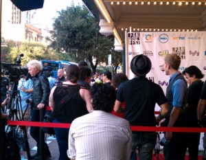 A heavily-botoxed Billy Idol loiters on the red carpet